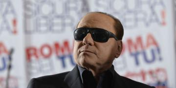 Silvio Berlusconi with cool black sunglasses