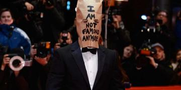 Labeouf paper bag red carpet metamodernism art