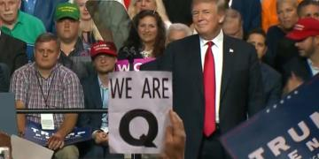 QAnon appearing at Trump rallies.