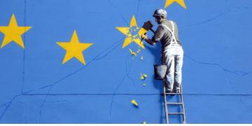 Banksy Brexit mural of man chipping away at EU flag in Dover