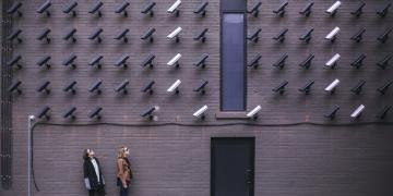 Women being watched by cameras