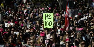 A Women's March protester holds up a MeToo sign